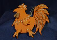 A rooster announces the sunrise with its singing and is a symbol of vigilance. According to folk tradition, a rooster protects the house and its residents from lightning and fire. Let the rooster keep your fireplace safe, in a combination of light and dark clay.